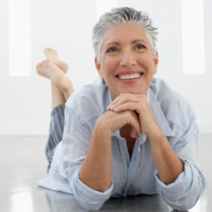 Image of a patient who is happy about the endless opportunities that dentures have given her.