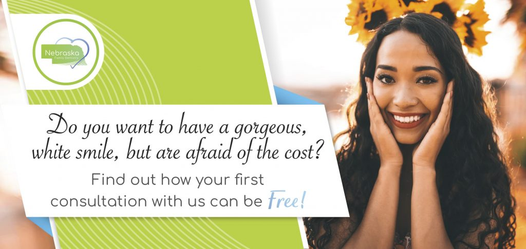 "Image of a banner asking if ""You want to have a gorgeous white smile, but are afraid of the cost?"" Coddington Dental can explain all of your options, including an implant bridge."